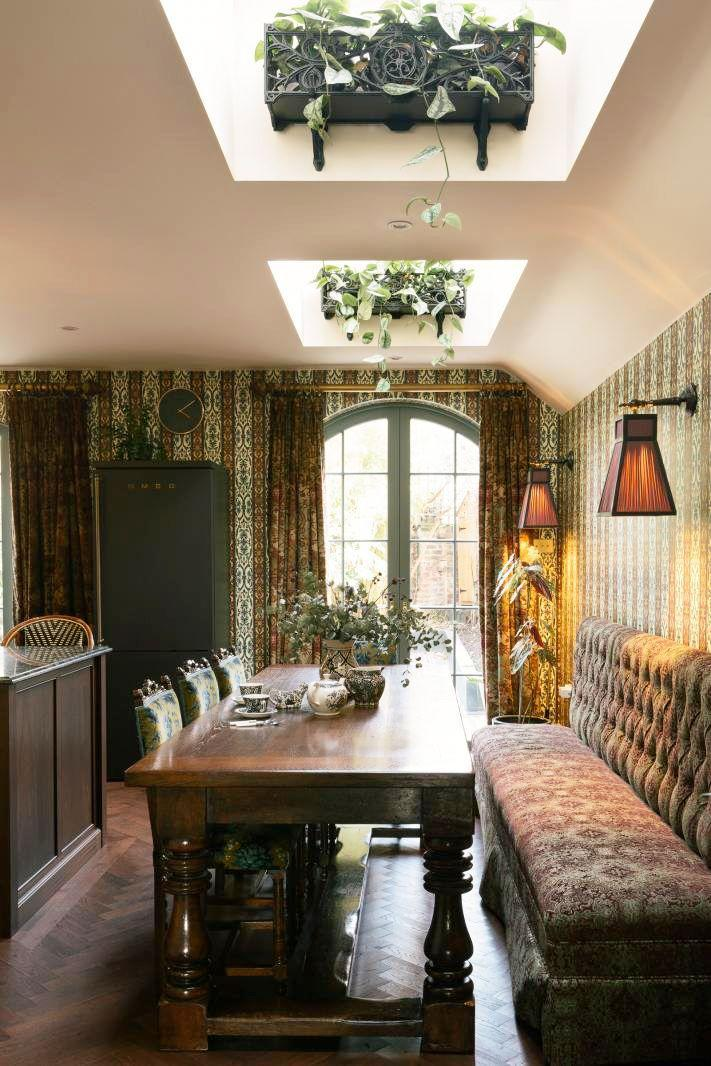 <p>Contemporary kitchen or dreamy Victorian bistro? Everything in this deVOL kitchen contributes to the narrative of European nostalgia, from the olive green Smeg refrigerator camouflaging against the House of Hackney wallpaper to the wrought iron window boxes fastened to the skylight niches. We're in love. </p>