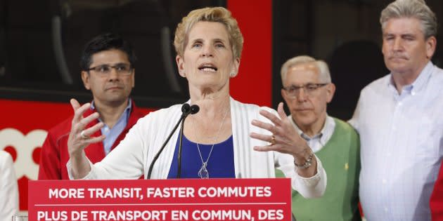 Ontario Liberal leader Kathleen Wynne speaks in front of the O-Train at a campaign stop in Ottawa on May 17, 2018.