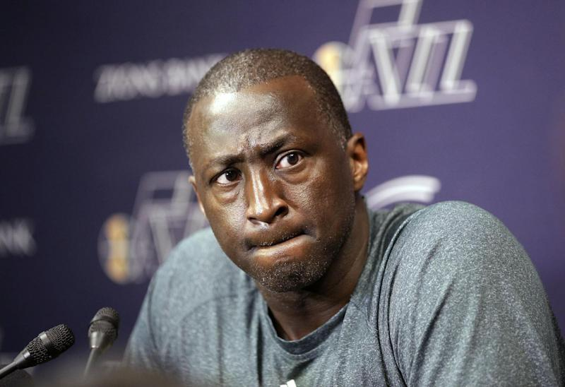 In this April 17, 2014, file photo, Utah Jazz coach Tyrone Corbin speaks to reporters on the day the Jazz cleaned out their lockers after a 25-57 season in Salt Lake City. The Jazz announced Monday, April 21, 2014, that the team won't be offering Corbin a new contract
