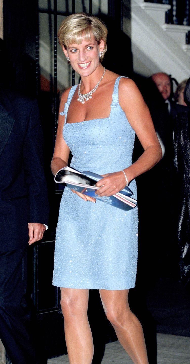 <p>In a light blue sequin mini holding a metallic purse at a Swan Lake performance in London. </p>