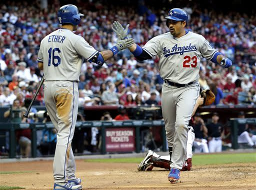 Los Angeles Dodgers' Adrian Gonzalez (23) celebrates his solo home run with teammate Andre Ethier (16) against the Arizona Diamondbacks during the fourth inning of a baseball game on Saturday, April 13, 2013, in Phoenix. (AP Photo/Matt York)