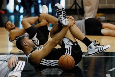 Jun 6, 2014; San Antonio, TX, USA; San Antonio Spurs guard Tony Parker (9) warms up during basketball practice at Spurs Practice Facility. Mandatory Credit: Soobum Im-USA TODAY Sports