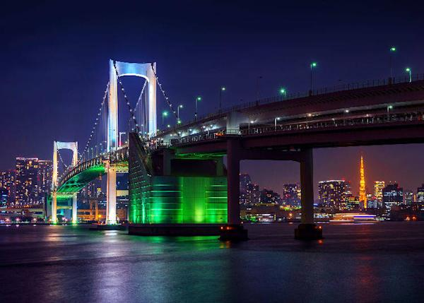 The iconic scenery of Rainbow Bridge with central Tokyo in the background.