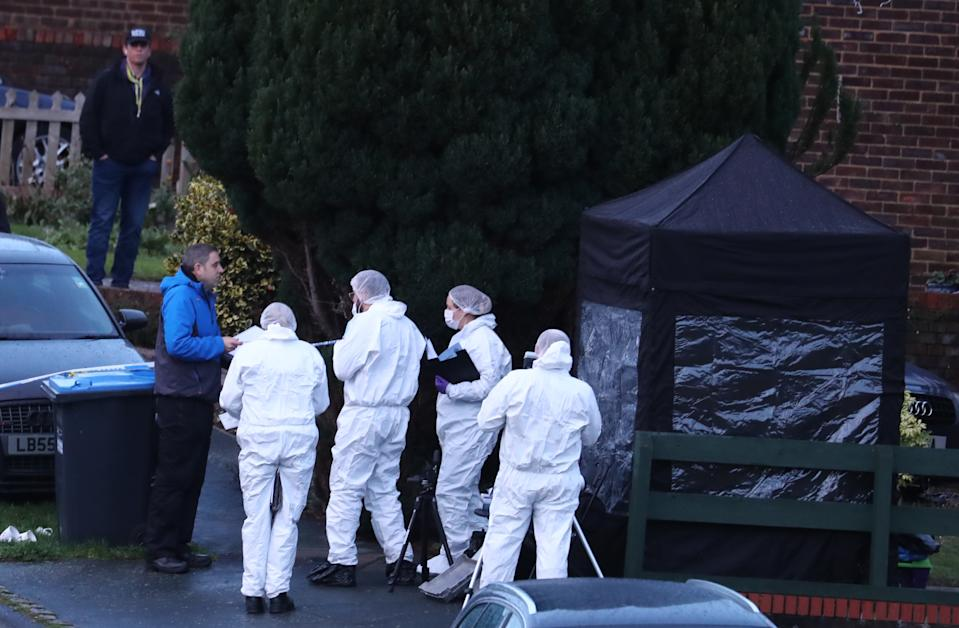 Police forensics officers at a scene in Hazel Way, Crawley Down. (PA)