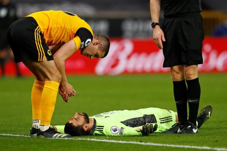 Wolves goalkeeper Rui Patricio (centre)was stretchered off after lengthy treatment for a head injury