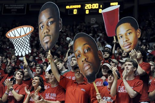 Mississippi fans cheer during an NCAA college basketball game against Mississippi State in Oxford, Miss., Wednesday, Jan. 18, 2012. (AP Photo/The Oxford Eagle, Bruce Newman) NO SALES MAGS OUT MANDATORY CREDIT
