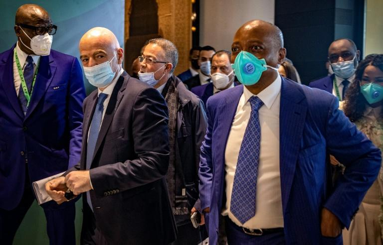 FIFA president Gianni Infantino (left) and new CAF president Patrice Motsepe (right) arrive for the general assembly of the African football body in Rabat