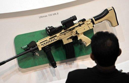 An Ultimax 100 MK8 weapon manufactured by ST Kinetics displayed at the Singapore Airshow in February 2012. Singapore, better known for its clean-cut image and electronics exports, is seeking a place in the global arms industry by exploiting technological expertise honed on its own amply funded military
