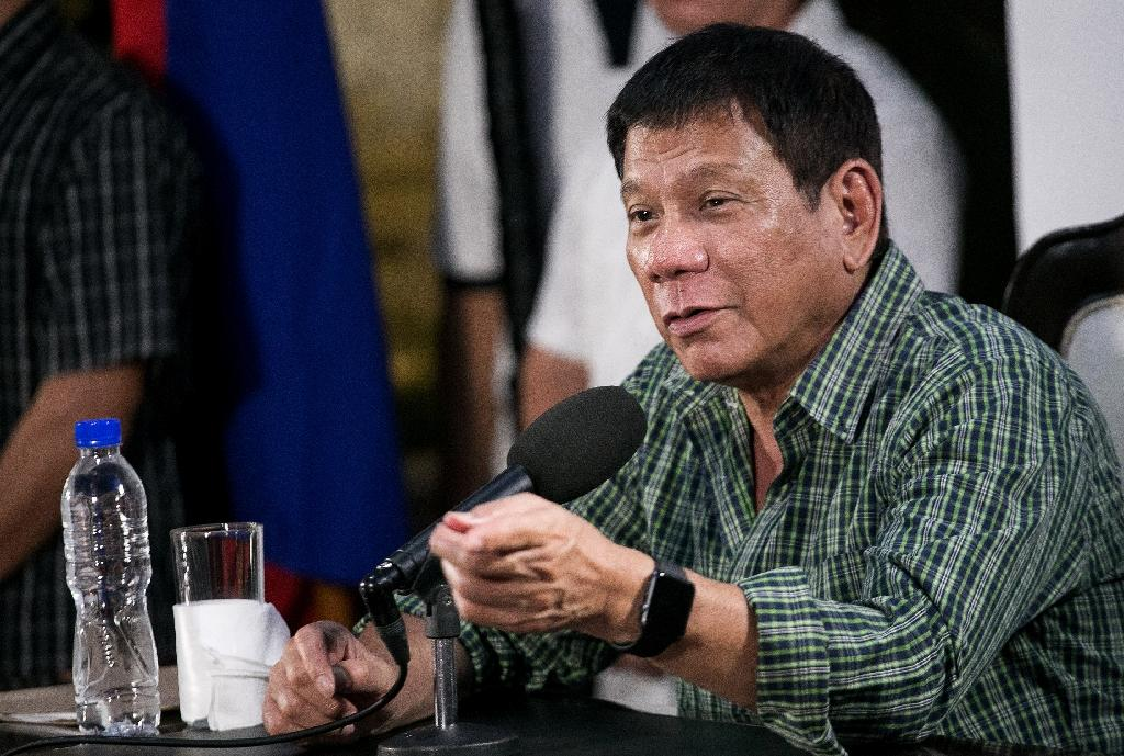 Philippines' president-elect Rodrigo Duterte was voted in on an anti-crime agenda, pledging to kill tens of thousands of criminals (AFP Photo/Manman Dejeto)