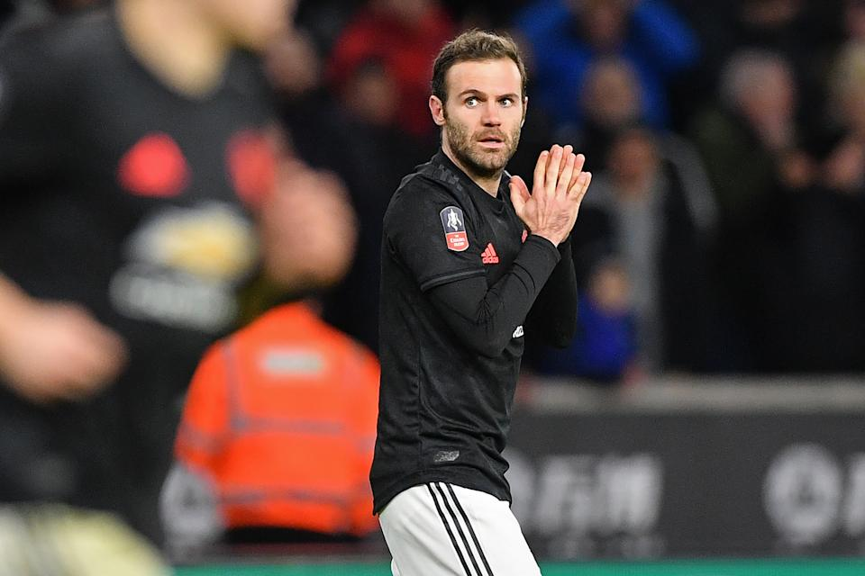Manchester United's Spanish midfielder Juan Mata reacts after missing a chance. (Credit: Getty Images)