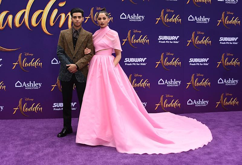 "Mena Massoud, left, and Naomi Scott arrive at the premiere of ""Aladdin"" on Tuesday, May 21, 2019, at the El Capitan Theatre in Los Angeles. (Photo by Jordan Strauss/Invision/AP)"