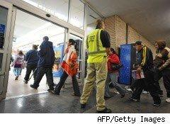Walmart security watches shoppers enter on Black Friday