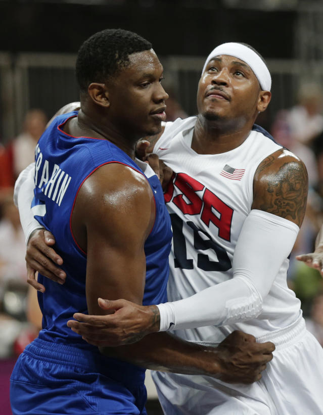 France's Kevin Seraphin battles for position against United States' Carmelo Anthony during the first half of a preliminary men's basketball game at the 2012 Summer Olympics, Sunday, July 29, 2012, in London. The U.S. men beat France 98-71. (AP Photo/Charles Krupa)