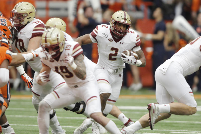 Boston College's AJ Dillon runs up the middle during the first quarter of an NCAA college football game against Syracuse in Syracuse, N.Y., Saturday, Nov. 2, 2019. (AP Photo/Nick Lisi)