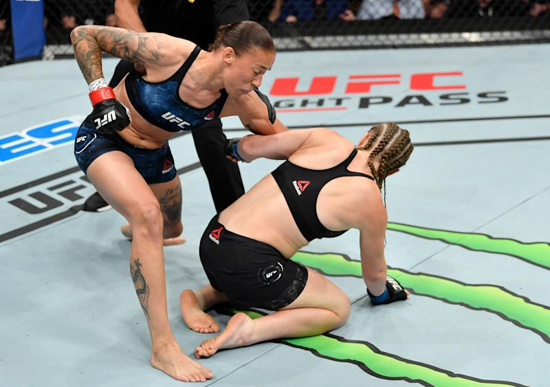 SACRAMENTO, CALIFORNIA - JULY 13: (L-R) Germaine de Randamie of the Netherlands punches Aspen Ladd in their women's bantamweight bout during the UFC Fight Night event at Golden 1 Center on July 13, 2019 in Sacramento, California. (Photo by Jeff Bottari/Zuffa LLC/Zuffa LLC via Getty Images)
