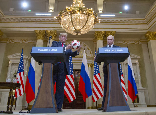 Trump accepts a soccer ball presented to him by Putin during a joint press conference in Helsinki on Monday. (Photo: Pablo Martinez Monsivais/AP)