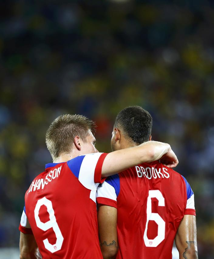 John Brooks of the U.S. (R) and teammate Aron Johannsson celebrate their win against Ghana after their 2014 World Cup Group G soccer match at the Dunas arena in Natal June 16, 2014. REUTERS/Stefano Rellandini (BRAZIL - Tags: SOCCER SPORT WORLD CUP)