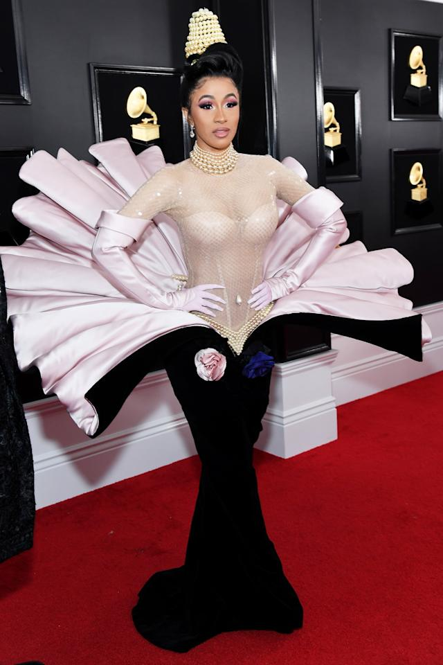 <p>Cardi B took her look for the 2019 Grammy Awards from Thierry Mugler's 1995 couture collection with this oyster shell dress, which she paired with a pearl necklace and matching hat. </p>