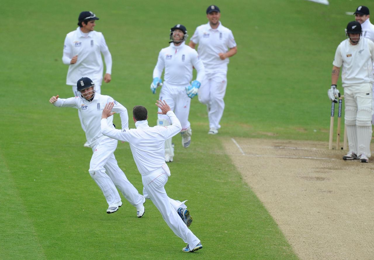 England's Graeme Swann (bottom) and Ian Bell (left) who caught out New Zealand's Doug Bracewell celebrate taking his wicket during the Second Investec Test match at Headingley, Leeds.