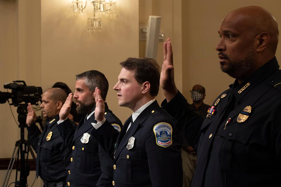 Four officers with the US Capitol Police are sworn in at Tuesday's hearing on the 6 January attack. (EPA)