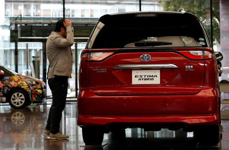 A man looks at Toyota Motor Corp's Estima Hybrid model at its headquarters in Tokyo