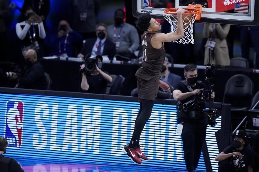 Portland Trail Blazers' Anfernee Simon competes in the Slam Dunk contest during basketball's NBA All-Star Game in Atlanta, Sunday, March 7, 2021. (AP Photo/Brynn Anderson)