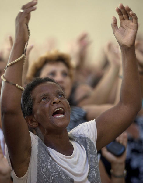 Catholics pray during a Sunday mass at the Mother of God sanctuary in Sao Paulo, Brazil, Sunday March 3, 2013. Catholics around the world attended the first Sunday masses since Benedict XVI stepped down as pope. Many prayed for a energetic, new leader to reinvigorate what many said was an ailing institution.(AP Photo/Andre Penner)