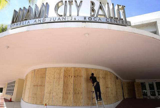 <p>Edward Pastrana installs wood shutters at the Miami City Ballet in Miami Beach, Fla., Thursday, Sept. 7, 2017. The National Hurricane Center issued a hurricane watch for the Florida Keys and parts of South Florida. Mandatory evacuations were issued for the Florida Keys and coastal areas in South Florida. (Photo: Marta Lavandier/AP) </p>