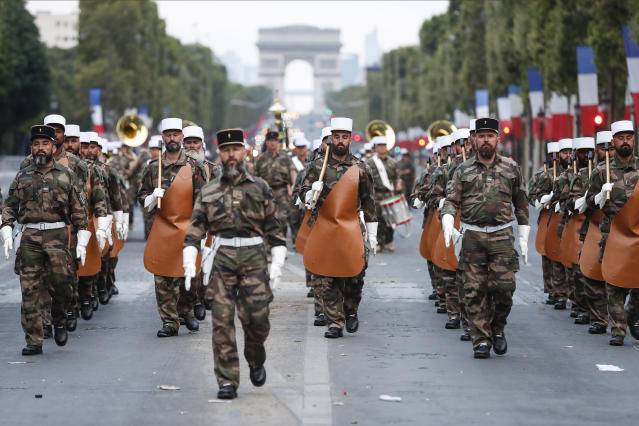 <p>Soldiers of the French Foreign Legion parade on the Champs-Élysées during a rehearsal for Bastille Day, early Wednesday, July 11, 2018, in Paris. (Photo: Jean-Francois Badias/AP) </p>