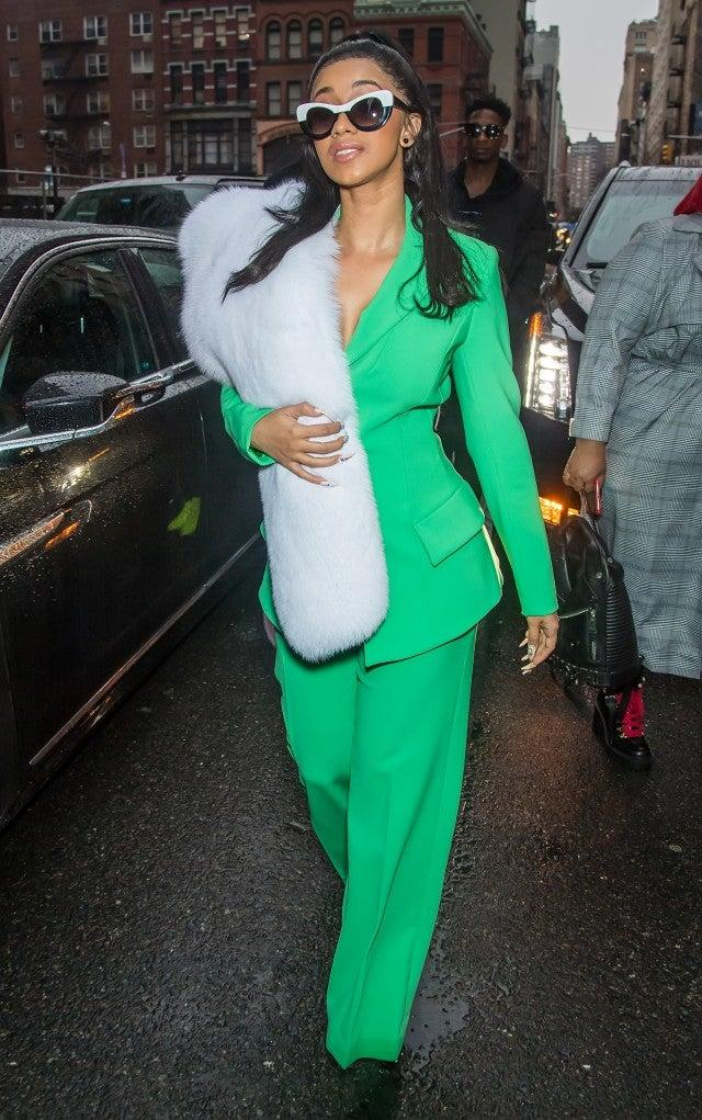 Cardi B in green pantsuit in 2018