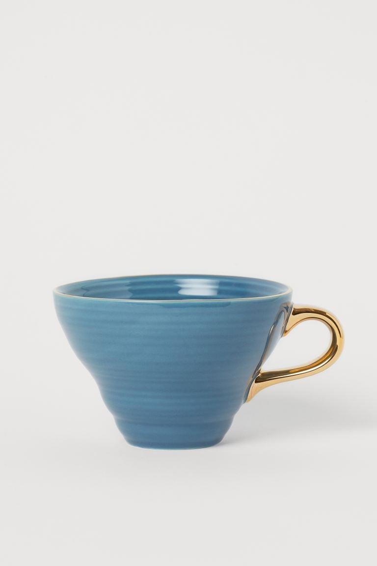 <p>The gold handles of this <span>Textured Porcelain Cup</span> ($10) and the refined texture make it that much more elevated.</p>