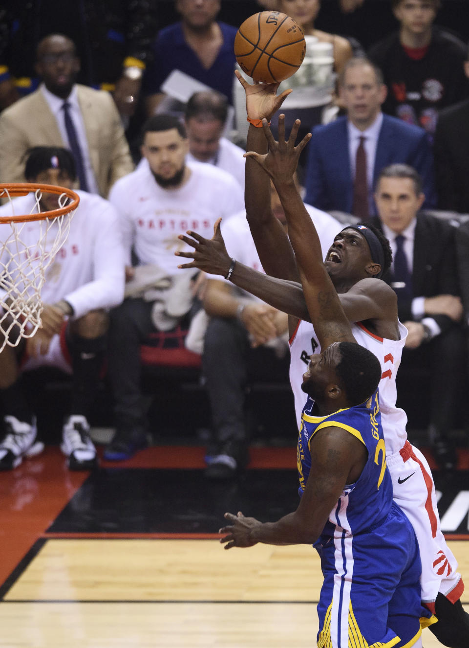 Toronto Raptors forward Pascal Siakam (43) drives to the net against Golden State Warriors forward Draymond Green (23) during first half NBA championship basketball finals action in Toronto on Thursday, May 30, 2019. (Nathan Denette/The Canadian Press via AP)