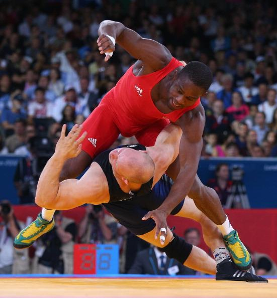 Melonin Noumonvi of France (top) competes with Rami Antero Hietaniemi of Finland during their Men's Greco-Roman 84 kg Wrestling 1/8 Final bout on Day 10 of the London 2012 Olympic Games at ExCeL on August 6, 2012 in London, England. (Photo by Cameron Spencer/Getty Images)