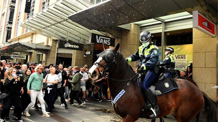 Anti-lockdown protesters throw objects at mounted police in Sydney