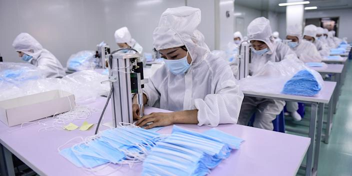 Workers producing face masks at a factory in Shenyang in China's northeastern Liaoning province on April 16.