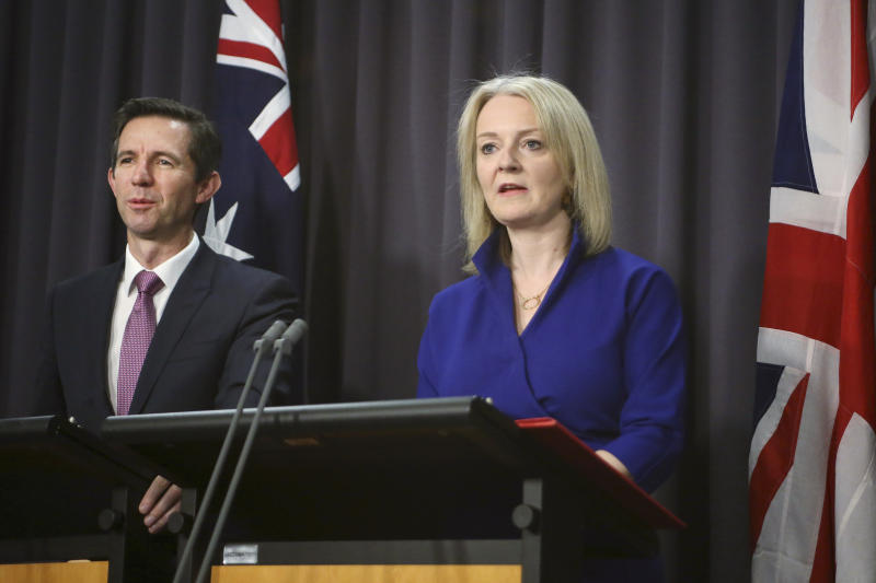 Australian Trade Minister Simon Birmingham, left, and British International Trade Secretary Liz Truss hold a press conference in Parliament House in Canberra, Australia, Wednesday, Sept. 18, 2019. Truss says she expects Britain will to strike a free trade deal with Australia within months of leaving the European Union. (AP Photos/Rod McGuirk)