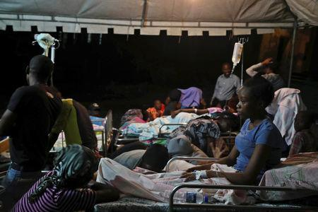 People injured in an earthquake that hit northern Haiti late on Saturday, are being looked after in a tent, in Port-de-Paix, Haiti, October 7, 2018. REUTERS/Ricardo Rojas