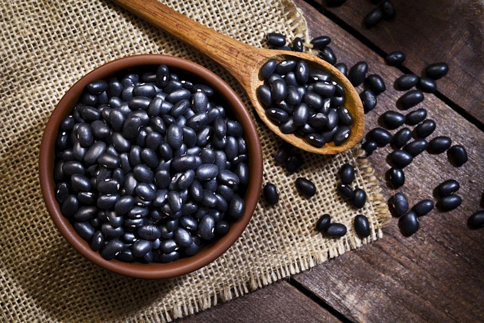 """<p>Just like chickpeas, black beans are loaded with gut-friendly fibers that could play a role in staving off inflammation. But that's not all. Thanks to their dark purple color, black beans are loaded with cancer-fighting flavonoids like anthocyanins. <a href=""""https://www.prevention.com/food-nutrition/recipes/a21637678/taco-recipes/"""" rel=""""nofollow noopener"""" target=""""_blank"""" data-ylk=""""slk:Tacos"""" class=""""link rapid-noclick-resp"""">Tacos</a> or <a href=""""https://www.prevention.com/food-nutrition/recipes/a20531708/spicy-black-bean-soup/"""" rel=""""nofollow noopener"""" target=""""_blank"""" data-ylk=""""slk:black bean soup"""" class=""""link rapid-noclick-resp"""">black bean soup</a>, anyone?</p><p><strong>Try it:</strong> <a href=""""https://www.prevention.com/food-nutrition/recipes/a20519766/black-bean-burgers-0/"""" rel=""""nofollow noopener"""" target=""""_blank"""" data-ylk=""""slk:Healthy Black Bean Burgers"""" class=""""link rapid-noclick-resp"""">Healthy Black Bean Burgers</a></p>"""