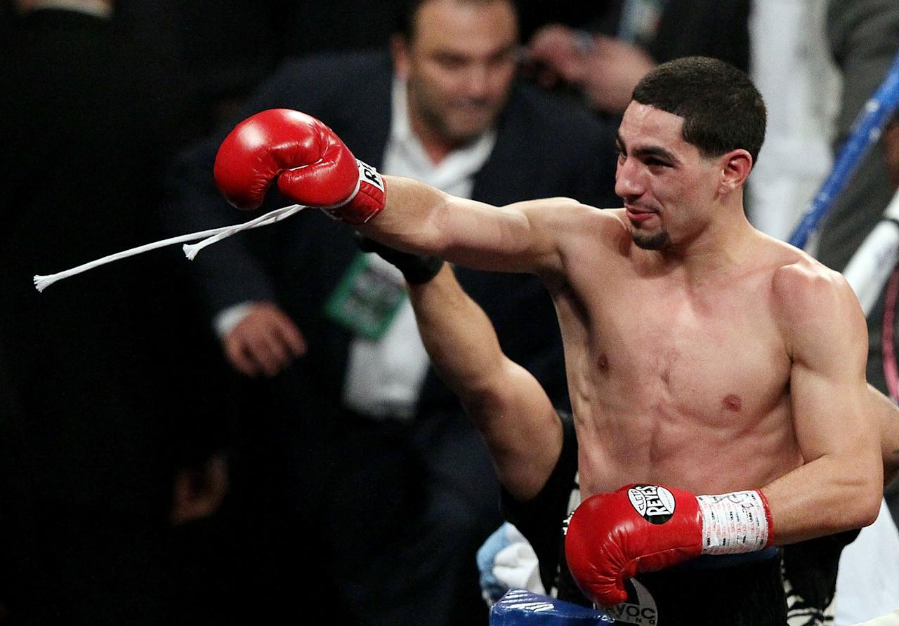 NEW YORK, NY - OCTOBER 20:  Danny Garcia celebrates after knocking out Erik Morales in the fourth round of their WBA Super, WBC & Ring Magazine Super Lightweight title fight at the Barclays Center on October 20, 2012 in the Brooklyn borough of New York City.  (Photo by Alex Trautwig/Getty Images)