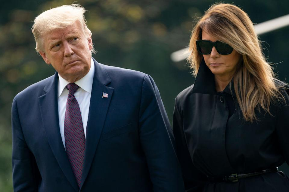 Donald Trump and first lady Melania Trump walk to the White House residence. Source: Getty
