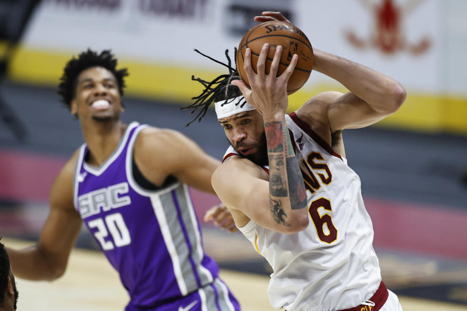 Cleveland Cavaliers' JaVale McGee (6) grabs a rebound next to Sacramento Kings' Hassan Whiteside (20) during the second half of an NBA basketball game Monday, March 22, 2021, in Cleveland. The Kings won 119-105. (AP Photo/Ron Schwane)