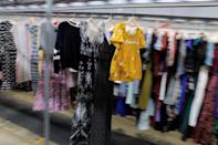 """Garments travel toward the steam tunnel at Rent the Runway's """"Dream Fulfillment Center"""" in Secaucus, New Jersey"""