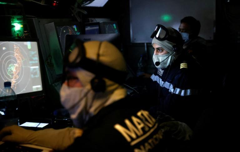 The La Fayette's crew wear masks against the coronavirus inside the ship's tactical operations centre