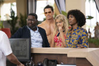 """This image released by Hulu shows Lil Rel Howery, from left, John Cena, Meredith Hagner and Yvonne Orji in a scene from """"Vacation Friends."""" (Jessica Miglio/20th Century Studios)"""