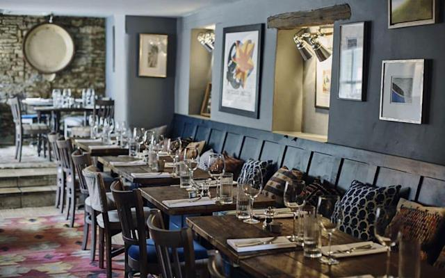 An insider's guide to the best pubs with rooms in the Cotswolds, featuring the top places to stay for good food, excellent walks, period charm, cosy fires and characterful rooms, in locations including Kingham, Tetbury and Winchcombe. The Wheatsheaf InnNorthleach, Cotswolds, England 8Telegraph expert rating A creeper-clad coaching inn turned arty, boutique haven. This rambling old property is furnished with immensely pleasing flair – a blend of tradition and contemporary chic. There are open fires, rugs on flagstone, wooden floors and retro school seats as dining chairs. The sophisticated menu offers great flavour combinations, the likes of roast parsnip and fennel salad with chestnuts, and mutton and apple pie with creamed potatoes. If there's space in the bar beforehand try an aperitif of Sloe Negroni. This is good walking country and there are several circular hikes from the doorstep. Read expert review From £81per night Check availability Rates provided by Booking.com • The best hotels in the Cotswolds The Five AllsFilkins, Cotswolds, England 9Telegraph expert rating A slew of celebrities frequent the hotel, headed by near-neighbour Kate Moss, plus artist Jake Chapman, who is an investor, and others. The old inn has a useful layout, with a large bar area, often crowded at weekends, and a spacious Alpine style sitting area, with sofas in front of a log fire and pine dressers where infused olive oil and homemade fudge are offered for sale. Chef and owner Sebastian Snow has fined tuned the concept of a gastropub, offering the likes of calves liver and bacon with bubble and squeak and beet relish, and chargrilled squid with garlic roasties. Read expert review From £110per night • The best family-friendly hotels in the Cotswolds The Ebrington ArmsEbrington, Cotswolds, England 8Telegraph expert rating Creaking with atmosphere, this is a 1640 building with Victorian additions. You walk into a bar/dining room that exudes warmth, with an inglenook fireplace, exposed beams and flagstone and wooden floor. Beyond are two more dining areas – complete with wood burning stove, and settles crafted from old barrels. Chef Ben Dulley offers short, understated menus which reflect his commitment to freshness, with many vegetables straight from surrounding Drinkwater Farm. Yet it's the local spirit that makes this pub particularly special: it's the social hub of the village and hosts live music. Rooms have a decanter of sherry, homemade biscuits and an eclectic mix of hardback books. Read expert review From £165half board Rates provided by Booking.com • The best Cotswolds hotels in and around Burford The Bull InnCharlbury, Cotswolds, England 8Telegraph expert rating A 16th-century coaching inn; The Bull oozes atmosphere with its inglenook fireplace, stone walls and beams. There's a modern, arty vibe too, with flamboyant furnishings and striking paintings from the Crane Kelman gallery in London. There are four glamorously devised bedrooms above the bar. Each is individually furnished – one has walls hand-painted by artist Fifi McAlpine, another is soothingly deep green. They all have fine linen and fluffy robes. The establishment has its own butchery, and does adventurous starters in the restaurant (red gurnard with verbena harissa anyone?). Read expert review From £99per night Check availability Rates provided by Booking.com • The best boutique hotels in the Cotswolds The Kingham PloughKingham, Cotswolds, England 8Telegraph expert rating A treat of a foodie destination in picture-pretty Kingham. Husband and wife team Emily Watkins and Miles Lampson wanted to keep a 'pubby' element while also celebrating great British cuisine and have devised a relaxing haven with pleasingly comfy décor. There's a well-frequented bar with squishy armchairs, a woodburner at one end and a fireplace at the other. The six bedrooms are different shapes and sizes with flourishes of attractive fabrics. Award-winning food is inspired by local produce; the likes of Windrush Valley goat cheese and pork from Paddock Farm, a few miles away. Read expert review From £145per night • The best hotels for spa breaks in England The Howard ArmsStratford-upon-Avon, Cotswolds, England 8Telegraph expert rating This appealingly stylish old pub is set in a quiet lane on the outskirts of Ilmington, a pink brick and golden stone Warwickshire village. The pub dates back several centuries and has evolved from a collection of barns. There are snoozy leather armchairs in front of a big stone fireplace, and hunting pictures on the walls. Friday nights are particularly convivial, Sundays too, with a regular quiz in the evening. All of the eight rooms have a sitting area; one has a four-poster, another a canopy bed decked in tartan. From his fennel and pumpkin seed bread, to spiced vegetarian tagine and rump of lamb with pea puree, chef Gareth Rufus offers beautifully presented dishes based largely on local ingredients. Read expert review From £110per night Check availability Rates provided by Booking.com • The best luxury hotels in the Cotswolds The Lion InnWinchcombe, Cotswolds, England 8Telegraph expert rating The Lion is a 16th-century coaching inn turned rustic-cool pub with rooms. Set in the heart of Winchcombe, which is regarded as the 'walking capital' of the Cotswolds, it makes a fine base for hiking weekends and touring ‒ and serves appealing brasserie food. A modern makeover has cleverly given the interior of this historic property a cosy yet light and bright look. It's a place of bleached wood, exposed stone walls and rugs on flagstone floors. The well-priced menu includes mains such as mushroom tagliatelle with spinach pesto to slow-roasted pork belly with creamed cabbage. Read expert review From £100per night Check availability Rates provided by Booking.com • The best spa hotels in the Cotswolds The Village PubCirencester, Cotswolds, England 8Telegraph expert rating The Village Pub certainly does what it says on the tin ‒ it's an inn and local hub. Yet it's also a handsome place of much mellow charm and wide appeal. The central point is a proper bar area with walls snugly decorated in deep aubergine; you can pop in to enjoy a pint of local Windrush ale beside the woodburner, a framed Barnsley cricket club T-shirt above it reflecting pride in local involvement. Yet as with most pubs, this is now principally a restaurant – offering plenty of space. The small, wholesome menu offers big flavours. Beds are clad in crisp cotton and soft checked throws; bathrooms are supplied with Gilchrist & Soames soaps and have showers over tubs. Read expert review From £99per night • The most romantic hotels in the Cotswolds The Plough InnCold Aston, Gloucestershire, England 8Telegraph expert rating This is a 17th-century Cotswold stone inn with a generous terrace. The Averys have retained the character of the building, particularly the original bar area which is now the dining room. Behind it, a previously unused room has become a sleek new bar area complete with creative flourishes such as stools fashioned from cart wheels. Locals still come for a pint and a chat, and weekenders descend from London, Birmingham and further afield. Much care is taken in sourcing food locally. Brasserie-style dishes range from courgette, sweetcorn and basil risotto to steaks from the charcoal oven. The three simply decorated attic rooms offer cosy comfort. Read expert review From £80per night • The best hotels with gardens in England The Royal OakTetbury, Cotswolds, England 8Telegraph expert rating Husband and wife team Chris York and Kate Lewis have put a lot of effort into creating a community venue, and there's been enthusiastic feedback from locals. Décor has been kept simple so as to show off the character of this old building. There's a warm bar/saloon on the ground floor, complete with two fireplaces, a reconditioned jukebox and a bar fashioned from recycled church panelling. Across a cobbled terrace from the main building, the former skittles alley has been converted into a six-bedroom annexe. All the rooms are kitted out with evocative Bisque Tetro radiators and are decorated in soothing colours. There's a choice of good bistro-style dishes from roast butternut squash salad to real-ale battered cod. Read expert review From £75per night