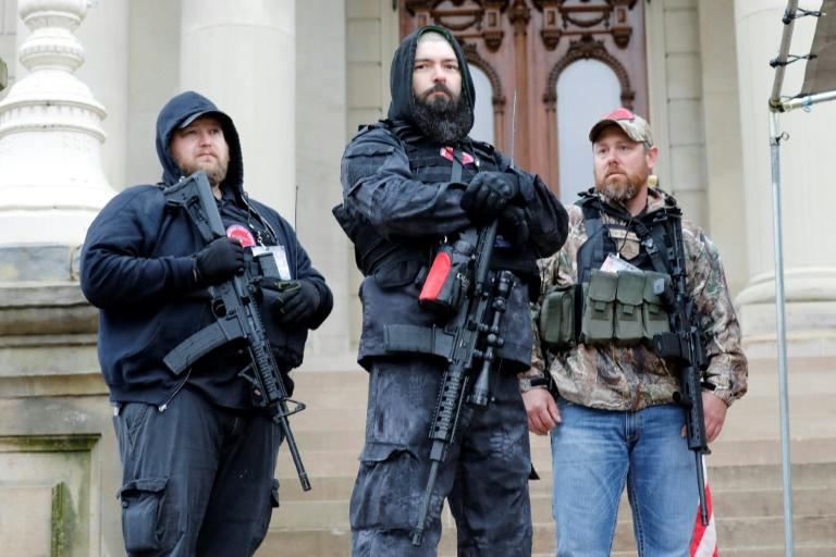 """Armed demonstrators have taken part in """"reopen"""" protests in states including Michigan, where they entered the capitol building in Lansing (AFP Photo/JEFF KOWALSKY)"""