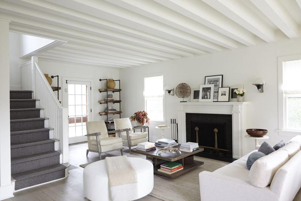 """<p>""""If you have a rustic floor, you only need one more wood piece in the room,"""" says Hill. """"Then you can have a glass piece, a metal etagere, and fabrics."""" All white upholstery and white walls are a blank canvas for an eclectic mix of accessories in this <a href=""""https://www.elledecor.com/design-decorate/house-interiors/g25750643/inside-a-gorgeously-restful-hamptons-farmhouse/"""" rel=""""nofollow noopener"""" target=""""_blank"""" data-ylk=""""slk:Hamptons farmhouse"""" class=""""link rapid-noclick-resp"""">Hamptons farmhouse</a>.<br><br></p>"""