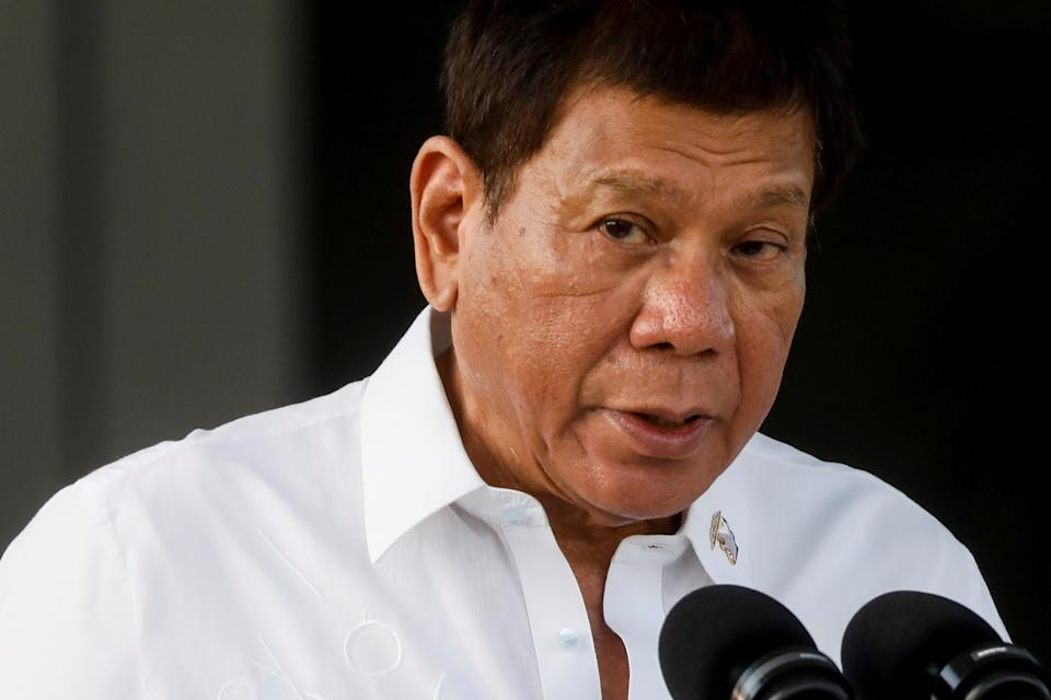 FILE PHOTO: Philippine President Rodrigo Duterte speaks during the arrival ceremony for the first COVID-19 vaccines to arrive in the country, at Villamor Air Base in Pasay, Metro Manila, Philippines, February 28, 2021. REUTERS/Eloisa Lopez