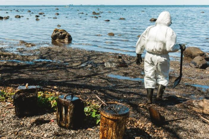 Volunteers help to clean spilled oil from MV Wakashio in Riviere des Creoles