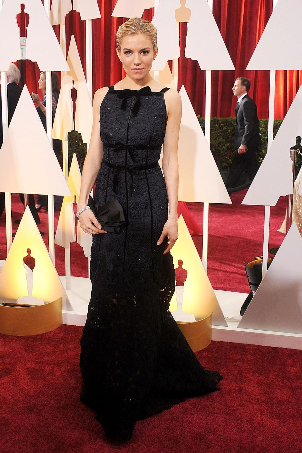 """<h2>Sienna Miller, 2015</h2><br>For his red carpet debut designing for Oscar de la Renta, Peter Copping made quite the impression with this bow-embellished, square neck gown on Sienna Miller.<br><br><em>Sienna Miller in Oscar de la Renta.</em><span class=""""copyright"""">Photo: Gregg DeGuire/WireImage/Getty Images. </span>"""